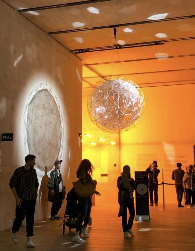 """2014 piece called """"Stardust particle"""" – a geometric, disco-like ball which hangs in the hallway outside the entrance to the exhibit"""